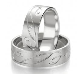 Romantyczne obrączki ślubne z białego złota z fantazyjną linią